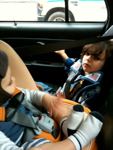 NYC Taxi: 1y/o rear-facing in Combi Coccoro & 4y/o in Ride Safer Travel Vest