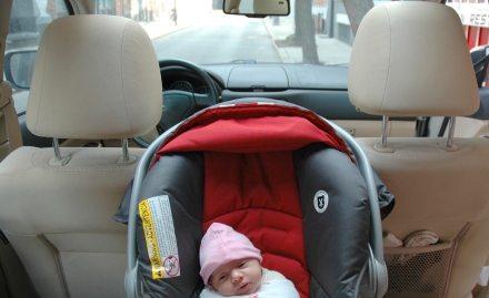 Infant in a Graco Snug Ride 35 (yes, the harness straps are buckled & snug - the blanket is OVER the straps, giving the baby a snug swaddled feeling